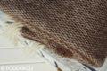 Detail hnedo - bielej modernej deky